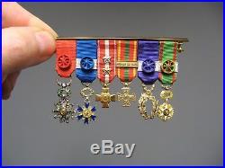 Décoration. Barrette avec 6 Médailles miniatures. Or, argent, diamants