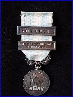 Médaille Coloniale + très rare agrafe Côte d'Ivoire à clapet arrondi + AOF