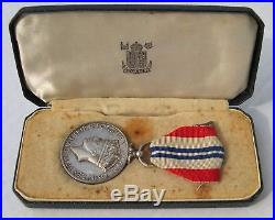Médaille anglaise THE KING'S MEDAL FOR COURAGE IN THE CAUSE OF FREEDOM