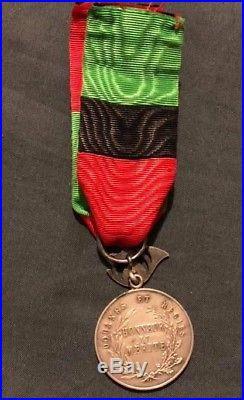 Médaille d'honneur des douanes et régies de l'Indochine, 1er type variante