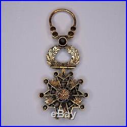 Médaille miniature de la légion d'honneur en or, avec diamants et émeraudes