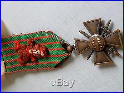 Une Médaille Croix de Guerre 1914-1916 avec un porte bonheurs au dos militaria